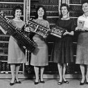 """""""Left: Patsy Simmers, holding ENIAC board Next: Mrs. Gail Taylor, holding EDVAC board Next: Mrs. Milly Beck, holding ORDVAC board Right: Mrs. Norma Stec, holding BRLESC-I board."""" (Source: US Army Photo, number 163-12-62, Public domain, via Historic Computers Images of the ARL Technical Library.)"""