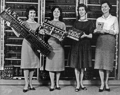 """Left: Patsy Simmers, holding ENIAC board Next: Mrs. Gail Taylor, holding EDVAC board Next: Mrs. Milly Beck, holding ORDVAC board Right: Mrs. Norma Stec, holding BRLESC-I board."" (Source: US Army Photo, number 163-12-62, Public domain, via Historic Computers Images of the ARL Technical Library.)"