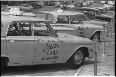 "Warren K. Leffler, photographer, ""Taxi cabs with sign 'White only, Becks cabs' on side, Albany, Georgia,"" created/published: August 18, 1962. Library of Congress Prints and Photographs Division, call number LC-U9-8340-29."