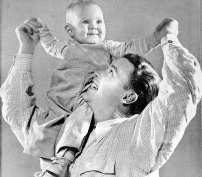 Cover photo, by Harold M. Lambert, from the June 1950 issue of Hearthstone magazine. Shows a man holding his child on his shoulder. (Protestant Family, Divinity School Library/Duke University Digital Collections.)