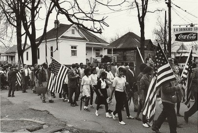 """Participants, some carrying American flags, marching in the civil rights march from Selma to Montgomery, Alabama in 1965,"" Peter Pettus, photographer. (Library of Congress)"