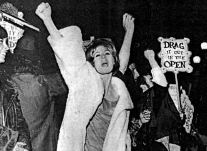 """Drag it out in the open"" protest photo from Victor Silverman's and Susan Stryker's 2005 documentary Screaming Queens: The Riot at Compton's Cafeteria."