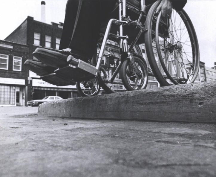 Before curb cuts. The 1968 Architectural Barriers Act and the 1990 Americans with Disability Act mandated accessible environments following enormous pressure from disability rights groups like ADAPT, but even basic accessibility still depends on compliance and people's attitudes. (EveryBody: An Artifact History of Disability in America/Smithsonian, National Museum of American History)